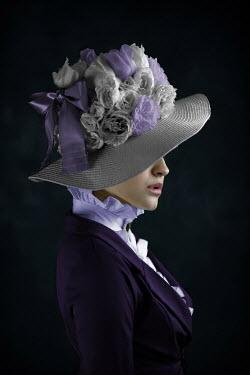 Ildiko Neer Victorian woman hiding face behind hat