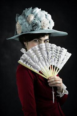 Ildiko Neer Victorian woman hiding face behind fan Women