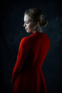 Ildiko Neer Young blonde woman in red coat