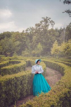 Joanna Czogala VICTORIAN WOMAN STANDING IN MAZE IN GARDEN Women