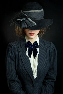 Natasza Fiedotjew Young elegant woman covering face with vintage hat