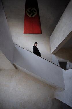 Natasza Fiedotjew Man in black holding rifle in nazi headquarters