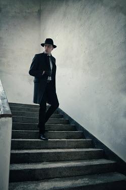 Natasza Fiedotjew Man in black going down stairs