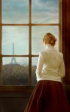 Drunaa Woman looking through window in Paris