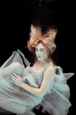 Rekha Garton Young woman in vintage dress underwater