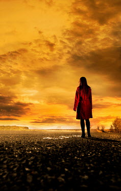 CollaborationJS WOMAN WAITING ON COUNTRY ROAD AT SUNSET Women
