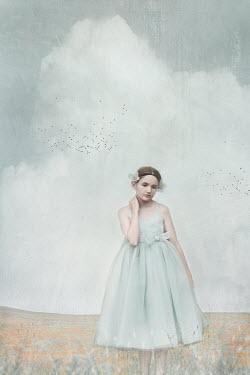 Anna Buczek Girl in vintage dress standing in field