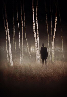 Lyn Randle Man in black coat walking to forest