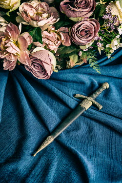 Mohamad Itani Dagger and bouquet of roses