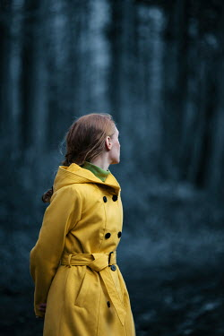 Magdalena Russocka Woman with yellow coat in forest