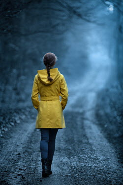 Magdalena Russocka Woman with yellow coat walking in forest
