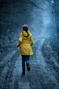 Magdalena Russocka Woman with yellow coat running in forest