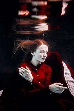 Rekha Garton Young woman in red vintage dress underwater