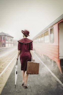 Natasza Fiedotjew Vintage woman with suitcase at train station