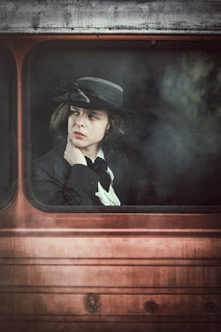 Natasza Fiedotjew Vintage woman looking out of train window