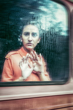 Natasza Fiedotjew Woman looking out of train window