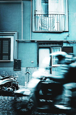 Irene Lamprakou Long exposure of scooter driving by apartment Men