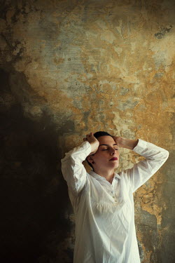 Mohamad Itani Young woman in white shirt by concrete wall Women