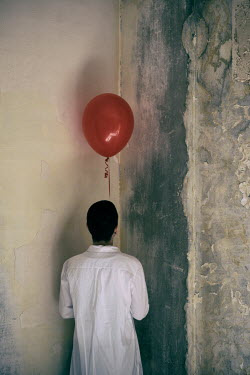 Mohamad Itani WOMAN WITH RED BALLOON STANDING IN CORNER Women