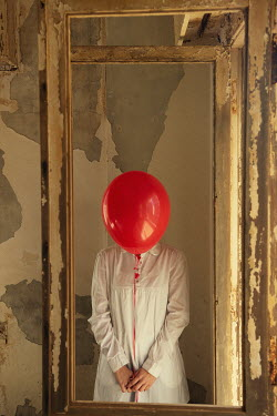 Mohamad Itani WOMAN WITH RED BALLOON STANDING IN DERELICT HOUSE Women