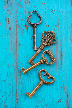 Mohamad Itani FOUR ANTIQUE KEYS ON TURQUOISE TABLE Miscellaneous Objects