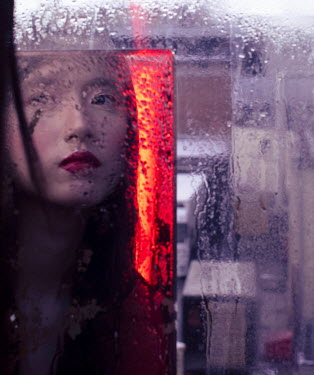 Marta Syrko ASIAN WOMAN REFLECTED BY WINDOW WITH CITY STREET Women