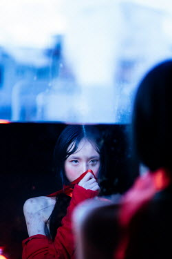 Marta Syrko ASIAN WOMAN REFLECTED BY WINDOW WITH INDUSTRIAL BUILDING Women
