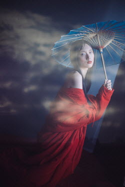 Marta Syrko ASIAN GIRL WITH PARASOL OUTDOORS IN MIST Women