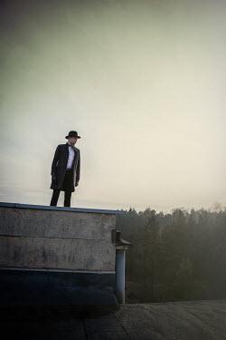 Natasza Fiedotjew Man in fedora hat on edge of roof