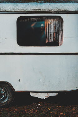 Dragan Todorovic WOMAN BY WINDOW IN DERELICT CARAVAN Women
