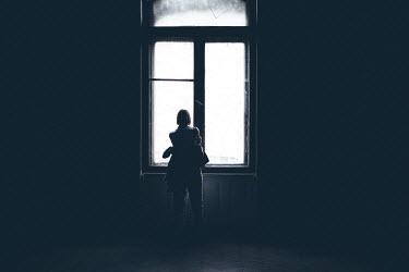 Dragan Todorovic WOMAN WATCHING AT WINDOW INSIDE DARK HOUSE Women