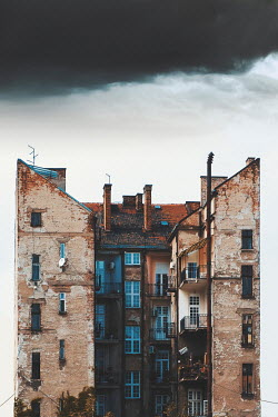 Dragan Todorovic EXTERIOR OF TALL WEATHERED APARTMENT BLOCK Houses
