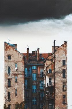 Dragan Todorovic EXTERIOR OF TALL WEATHERED APARTMENT BLOCK Houses