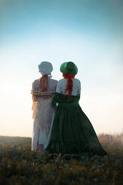 Ildiko Neer Two historical women standing in field