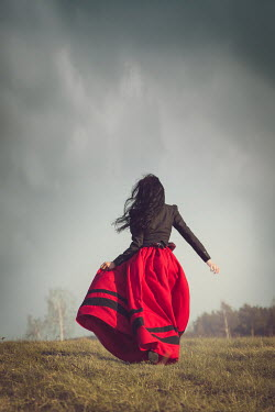 Joanna Czogala HISTORICAL WOMAN RUNNING IN FIELD FROM BEHIND Women