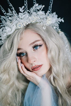 Jovana Rikalo CLOSE UP OF WOMAN IN PEARL FLORAL CROWN Women