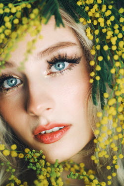 Jovana Rikalo CLOSE UP OF FEMALE FACE WITH YELLOW FLOWERS Women