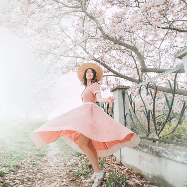Jovana Rikalo WOMAN IN FLOWING DRESS BY TREE IN BLOSSOM Women