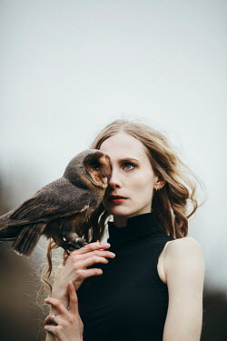 Jovana Rikalo SERIOUS WOMAN HOLDING BROWN OWL OUTDOORS Women