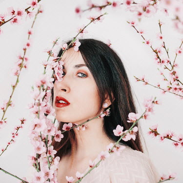 Jovana Rikalo CLOSE UP OF WOMAN WITH PINK BLOSSOM Women