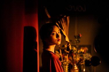 Marta Syrko SERIOUS ASIAN GIRL IN SHADOW INDOORS Women