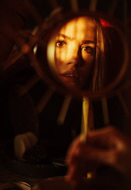 Marta Syrko REFLECTION OF WORRIED GIRL IN MIRROR AT NIGHT Women