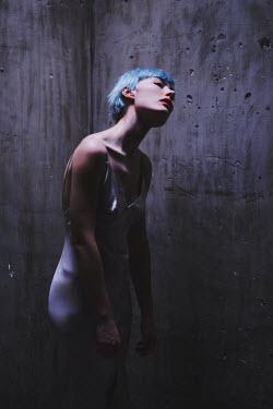 Anna Rakhvalova WOMAN WITH BLUE HAIR IN CONCRETE CELL Women