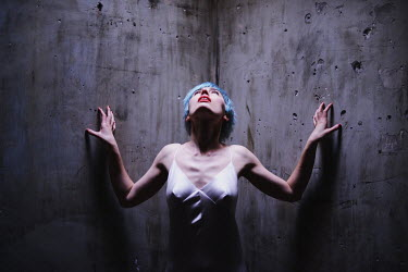 Anna Rakhvalova WOMAN WITH BLUE HAIR IN CONCRETE CELL Women