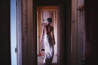 Anna Rakhvalova WOMAN IN SILK DRESS WALKING IN CORRIDOR Women