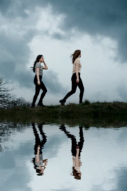 Rekha Garton TWO GIRLS REFLECTED IN LAKE AT DUSK Women