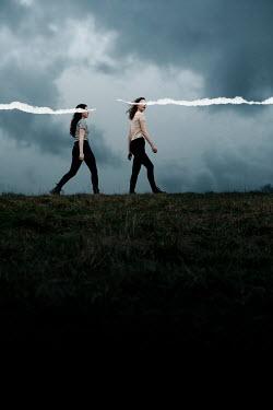 Rekha Garton TWO GIRLS WALKING IN FIELD WITH TEARS Women
