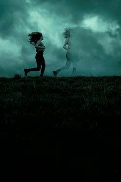 Rekha Garton TWO GIRLS RUNNING IN FOGGY FIELD AT DUSK Women