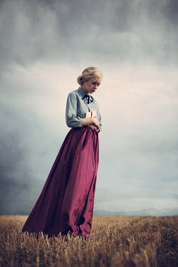 Magdalena Russocka historical woman with letter standing in field with mountainscape