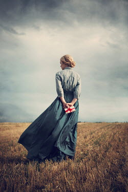 Magdalena Russocka historical woman with letter standing in field Women